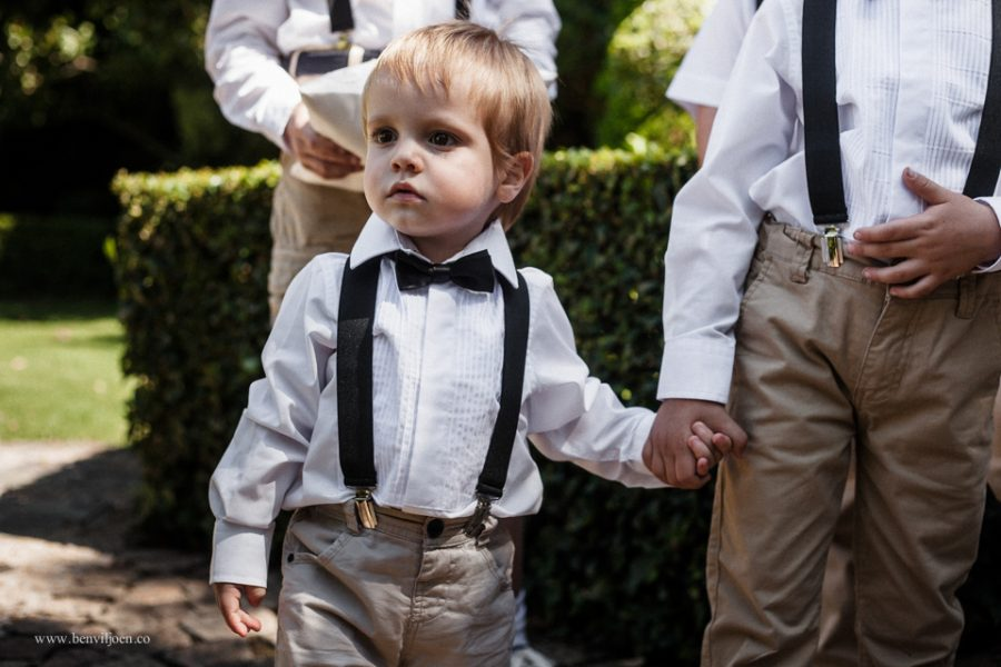 Page boys inquisitively entering the wedding ceremony area at a Secret Place wedding in Parys, South Africa