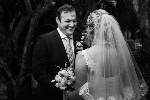 Groom extremely happy to be with his bride