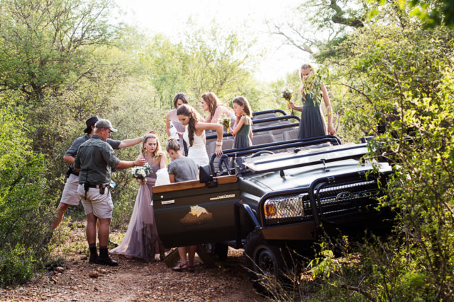 bride bridesmaids and a game drive vehicle