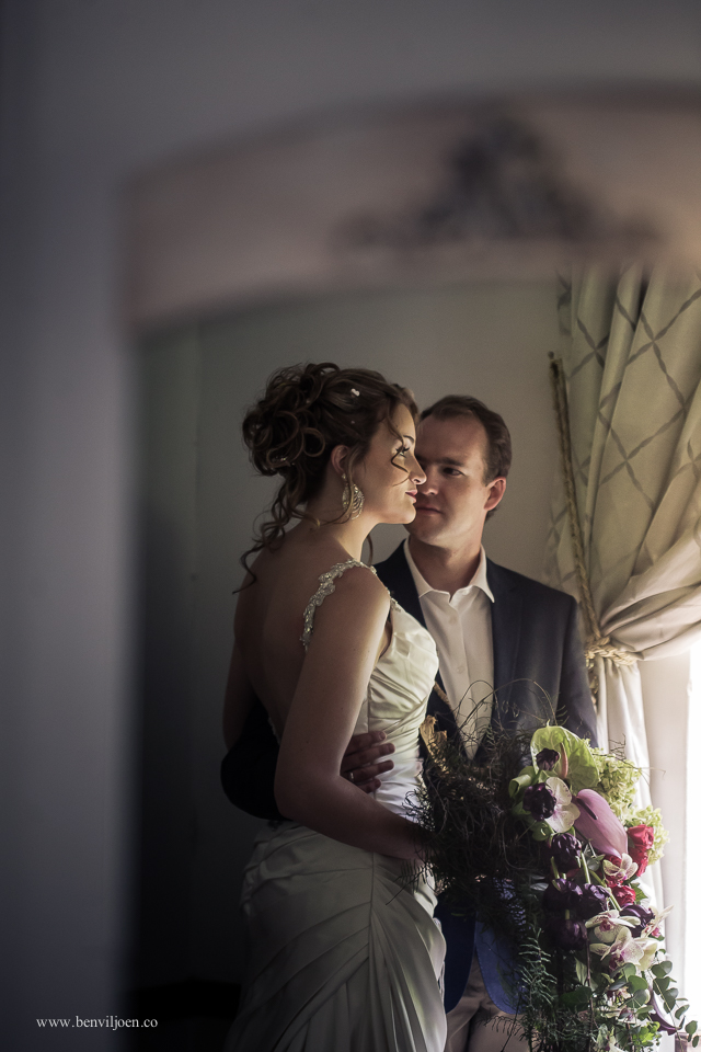 indoor portrait of bride and groom reflecting in a mirror