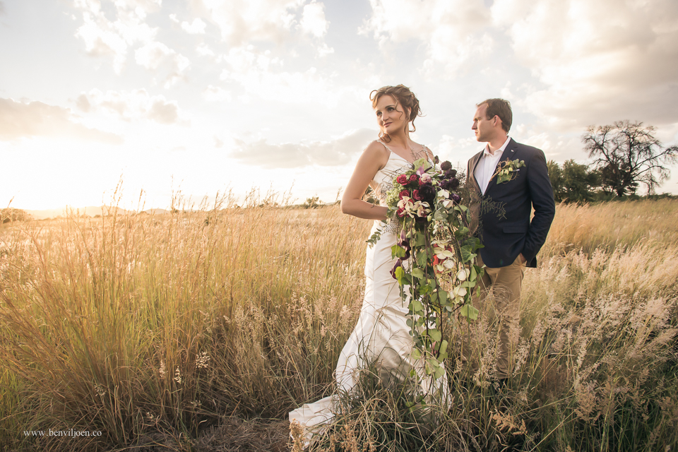 Bride and groom in veld near Parys after their wedding at Secret Place.