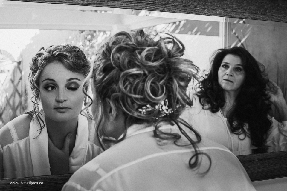 Bride checking her make-up with her mom in Parys at Secret Place