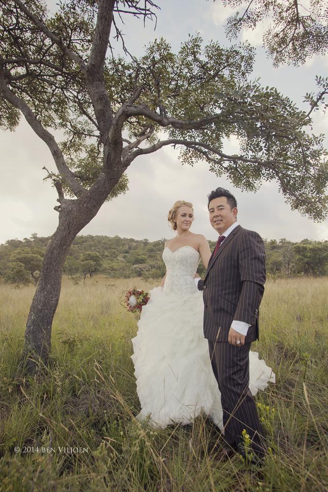 bride and groom together, bridal portrait under tree, short groom tall bride