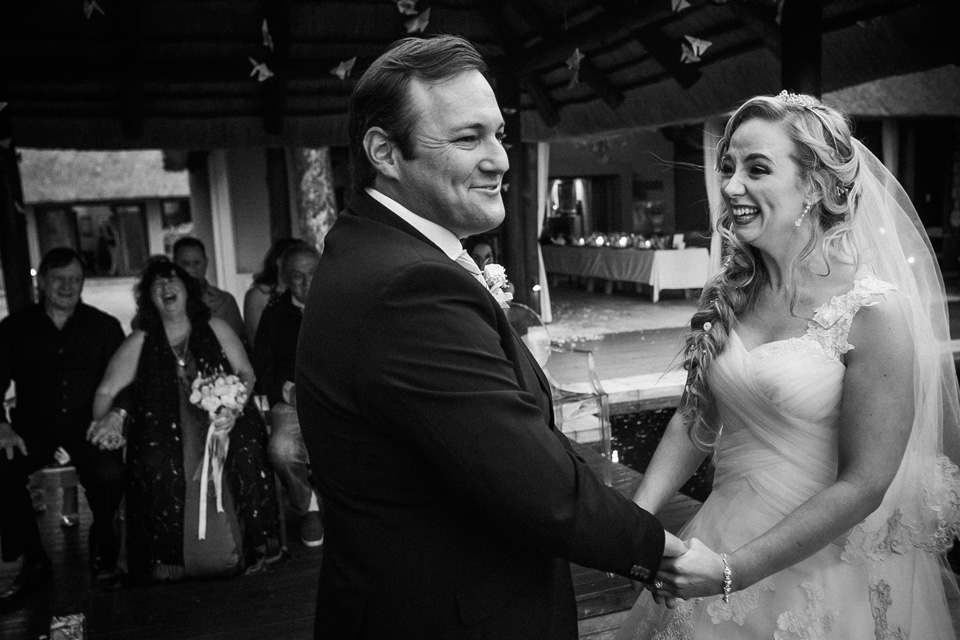 bride and groom laughing just before exchanging rings