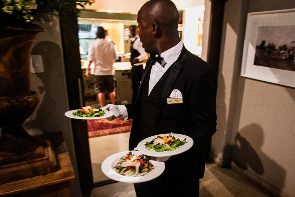 Waiter bringing food at a wedding reception in South Africa
