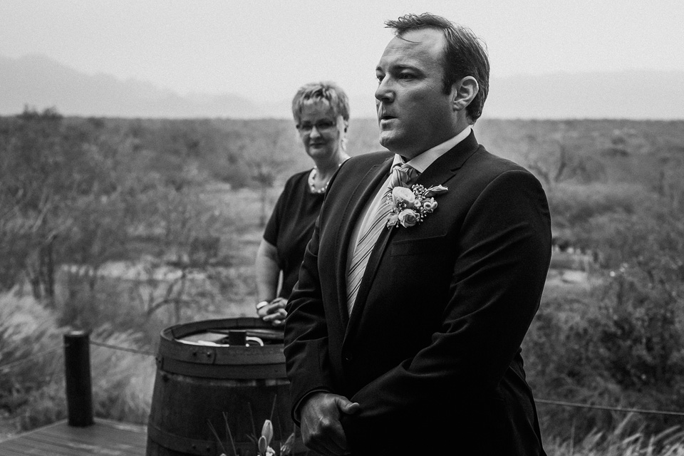 Nervous groom just before bride walks in